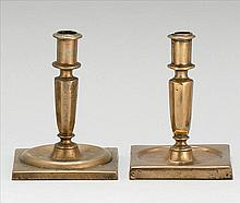 NEAR-MATCHED PAIR OF ANTIQUE CONTINENTAL BRASS CANDLESTICKS With turned socles, hexagonal stems and molded square bases. Height 6