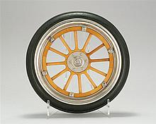RARE CASED SALESMAN'S SAMPLE OF A FORD MODEL T WHEEL Rubber wheel with chrome rim. Wooden spokes attached to laminated interior rim...
