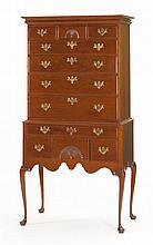 ELDRED WHEELER QUEEN ANNE-STYLE HIGHBOY In cherry. Upper case with molded cornice over three narrow drawers, the central of which wi...