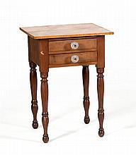 COUNTRY SHERATON TWO-DRAWER STAND In maple and curly maple. Replaced glass drawer pulls. Turned legs. Height 28.75