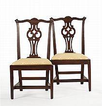 PAIR OF ANTIQUE AMERICAN CHIPPENDALE SIDE CHAIRS In mahogany with cyma-carved crest rails, owl's-eye pierced backsplats and square m..