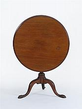 ANTIQUE AMERICAN CHIPPENDALE TILT-TOP TABLE In mahogany. Circular top set on a vasiform pedestal raised on cabriole legs ending in e...