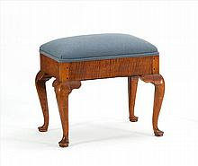 QUEEN ANNE-STYLE FOOTSTOOL In tiger maple with cabriole legs ending in pad feet. Top upholstered in blue fabric. Height 18