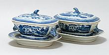 PAIR OF CHINESE EXPORT CANTON PORCELAIN COVERED SAUCE TUREENS With undertrays. Tureens with boar's head-form handles. Both with blue..