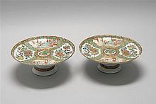 PAIR OF CHINESE EXPORT ROSE MEDALLION PORCELAIN TAZZE With figural designs on a bird and floral ground. Pink and green border on whi...