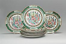 TEN CHINESE EXPORT FAMILLE ROSE PORCELAIN PLATES Green, red and songbird borders. Central design of butterflies, insects and flowers...