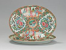 TWO CHINESE EXPORT ROSE MEDALLION PORCELAIN OVAL PLATTERS With figural designs on a bird and floral ground. Lengths 10.5