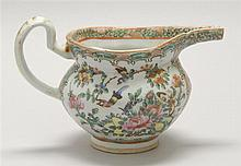 CHINESE EXPORT ROSE MEDALLION PORCELAIN SAUCE BOAT In helmet form with figural decoration. Length 7.25