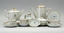 CHINESE EXPORT PORCELAIN COFFEE AND TEA SERVICE Includes a lighthouse-form coffeepot, height 9