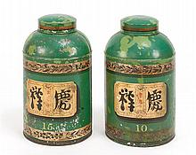 PAIR OF CHINESE TOLE LIDDED TEA CONTAINERS Painted decoration of gold and black on a green ground. One marked