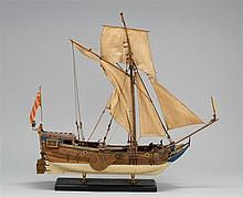 MODEL OF AN 18TH CENTURY SAILING VESSEL Plank-on-frame construction. Natural wood finish with painted blue highlights and white bott...