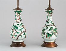 PAIR OF CHINESE EXPORT PORCELAIN VASES In gourd form with raised multicolor foliate decoration on a white ground. Mounted as table l...