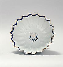 CHINESE EXPORT BLUE AND WHITE PORCELAIN FOOTED MONTEITH BOWL In ribbed and fluted form with gilt scalloped rim and armorial crest on...