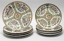 NINE CHINESE EXPORT ROSE MEDALLION PORCELAIN PLATES Figural designs on a bird and floral ground. Diameter of four 8.5