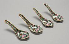SET OF FOUR ROSE MEDALLION PORCELAIN SOUP SPOONS In floral design. Length 6