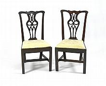 PAIR OF ANTIQUE ENGLISH CHIPPENDALE SIDE CHAIRS In mahogany with pierced and carved backs. Yellow damask upholstered seats.