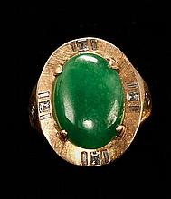 GREEN JADEITE CABOCHON RING 14kt yellow gold and diamond mount. Length of cabochon 16 mm. Size 5½.