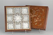CASED PEWTER CONDIMENT SET Consisting of nine shaped pewter dishes. Bone-inlaid case decorated with a figural landscape. Overall 18
