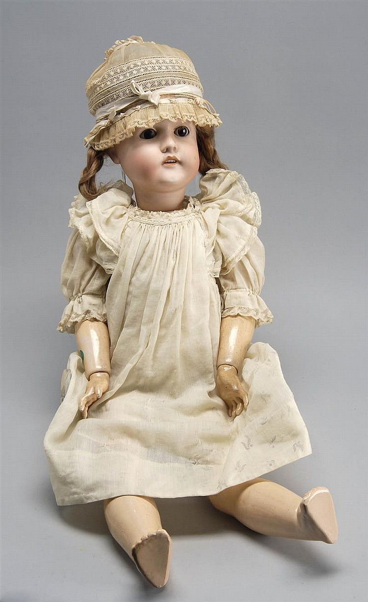 LARGE CIRCA 1905 GERMAN BISQUE-HEAD DOLL with brown eyes, open mouth, and composition ball-jointed body. Accompanied by period leath...