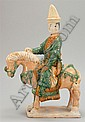 POTTERY EQUESTRIAN FIGURE Depicting a warrior on horseback. Removable head. Height 16½