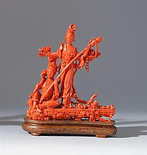 RED CORAL FIGURE GROUP Depicting two meiren standing on a rectangular platform with flowers and flower basket. Height 7.75