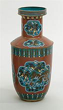 CLOISONNÉ ENAMEL VASE In rouleau form with guardian lion medallions on a key fret ground in brick red. Height 18