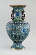 CLOISONNÉ ENAMEL VASE In baluster form with dragon handles. Body decorated with pahua and shou motif on a blue ground. Height 19.25