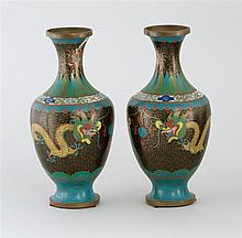PAIR OF CLOISONNÉ ENAMEL VASES In baluster form with five-claw yellow dragon design on a black ground. Height 9.1