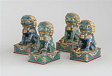 TWO PAIRS OF CLOISONNÉ ENAMEL LION FIGURES One pair in blue and the other in turquoise. One of each pair holds a pup and the other h...