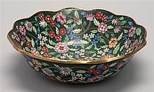 CLOISONNÉ ENAMEL BOWL In flower form with polychrome floral design on a green ground. Diameter 10
