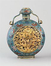 CLOISONNÉ ENAMEL VASE In pilgrim flask form with openwork dragon and cloud panels surrounded by flowers and Buddhistic symbols. Four...