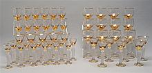 SET OF SIXTY GILT AND FROSTED GLASS STEMWARE Figural stems in the form of Napoleon Bonaparte. Set consists of twelve each: champagne...