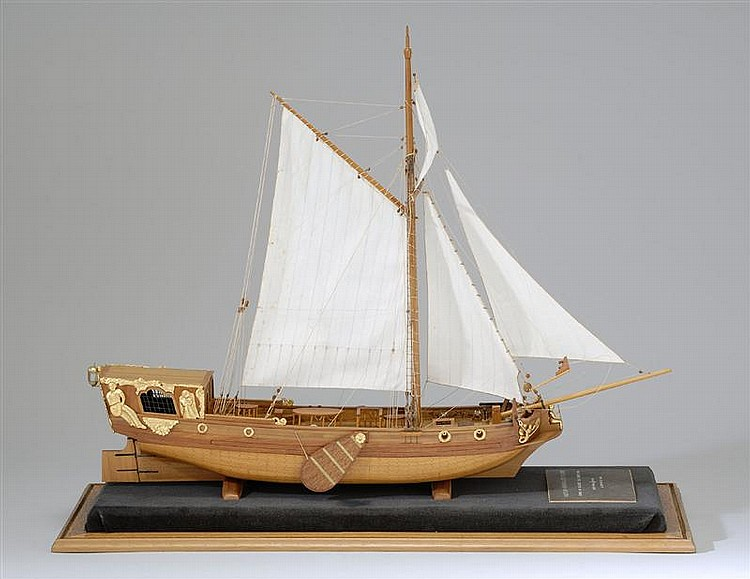 CASED MODEL OF A DUTCH ADMIRALTY YACHT Plank-on-frame construction. Natural wood finish with gilt applications. Case height 18½