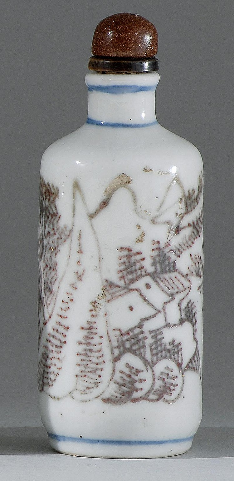 UNDERGLAZE RED PORCELAIN SNUFF BOTTLE In cylinder form with figural landscape design. Height 3