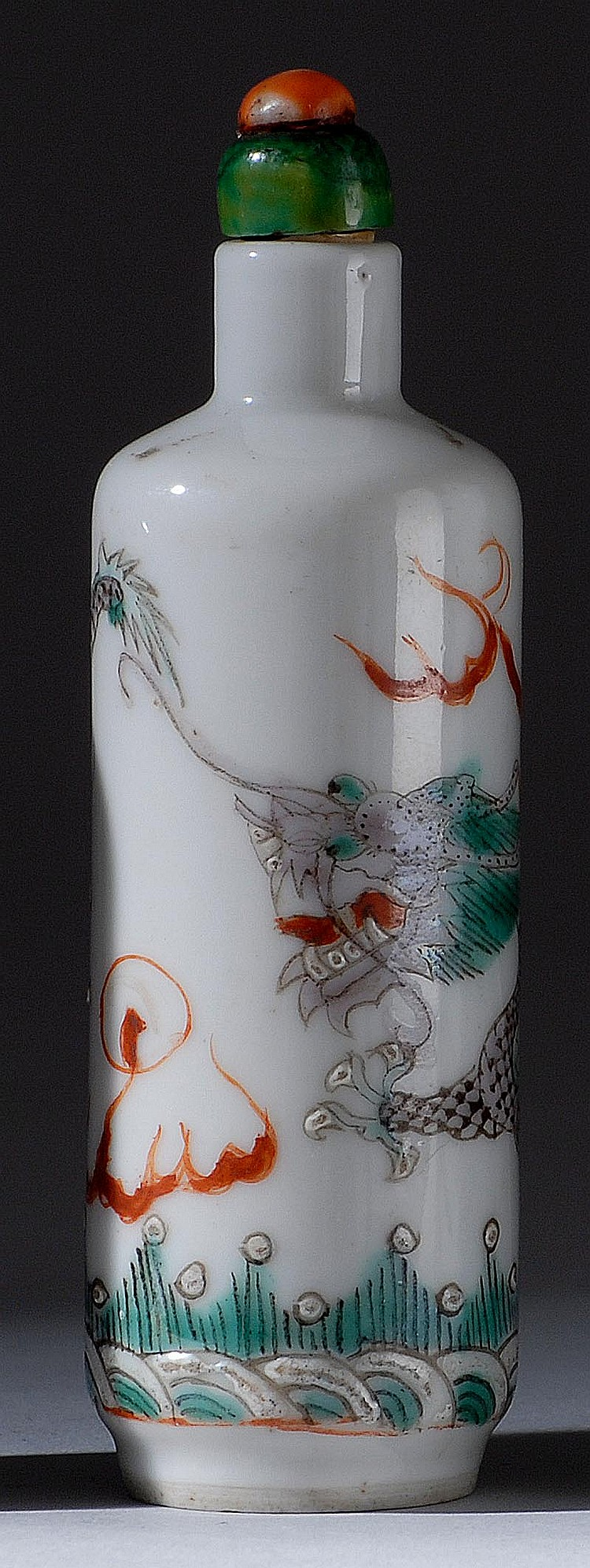 POLYCHROME PORCELAIN SNUFF BOTTLE In cylinder form with dragon decoration. Four-character Yongzheng mark on base. Height 3¼