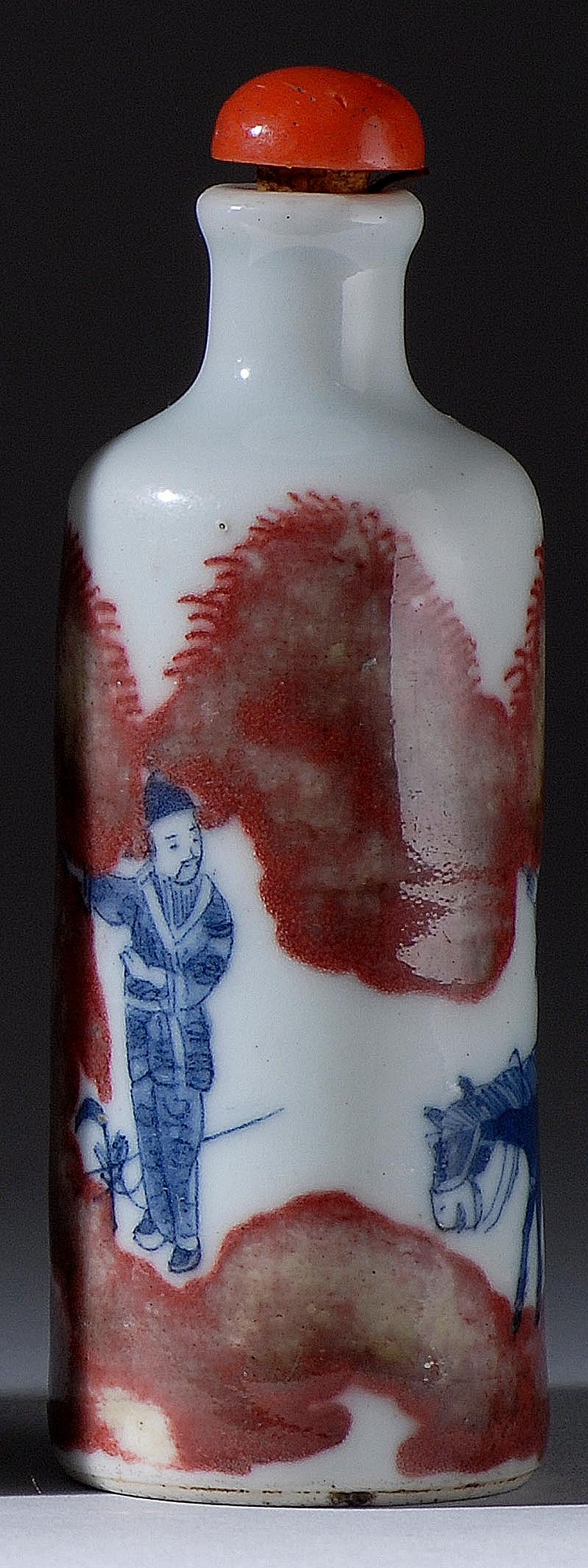UNDERGLAZE RED AND BLUE PORCELAIN SNUFF BOTTLE In cylinder form with equestrian figural landscape design. Six-character Yongzheng ma...