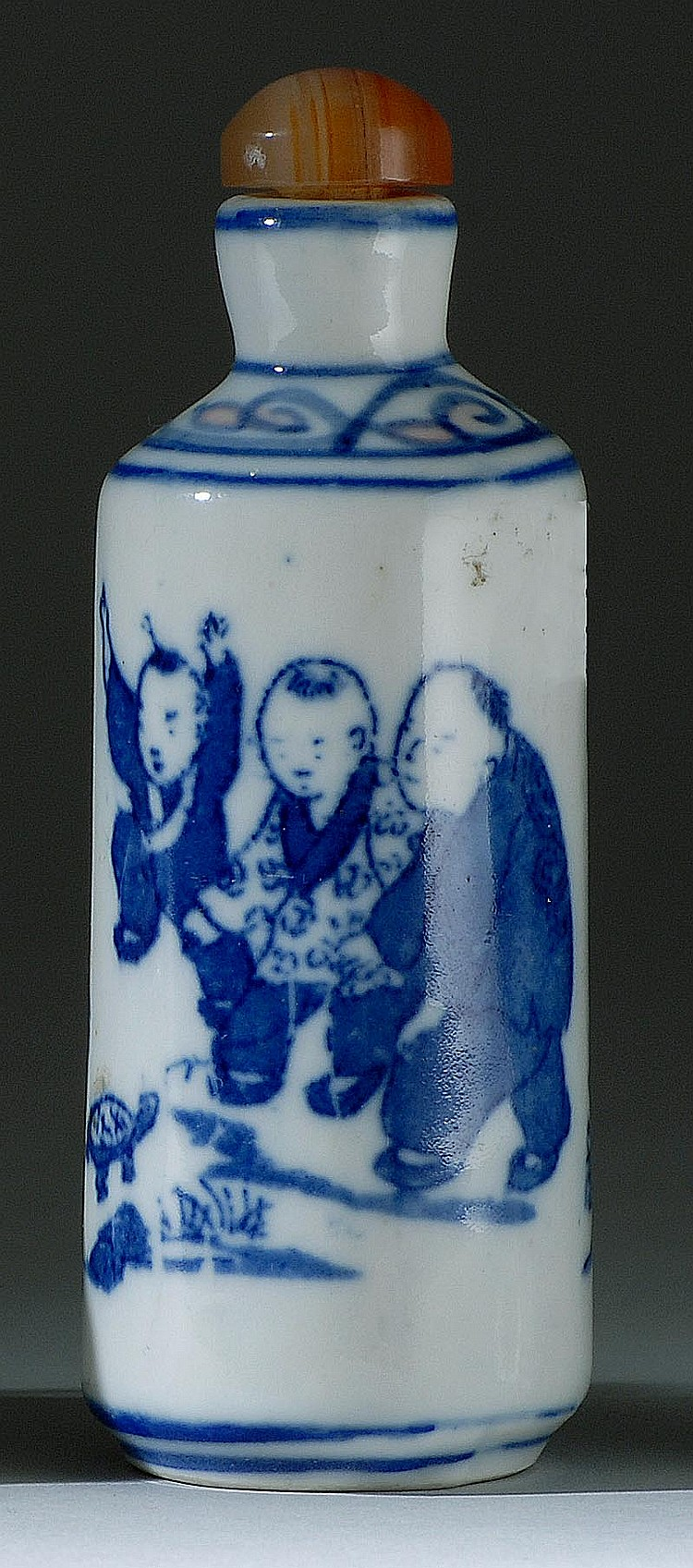 UNDERGLAZE BLUE PORCELAIN SNUFF BOTTLE In cylinder from with decoration of children playing with a turtle. Four-character Qianlong m...