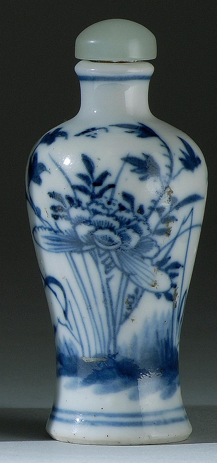 UNDERGLAZE BLUE PORCELAIN SNUFF BOTTLE In meiping form with flower and grasses design. Height 2¾