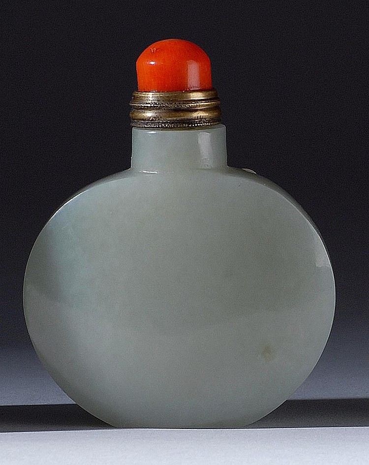 CELADON JADE SNUFF BOTTLE In flattened ovoid form. Height 2