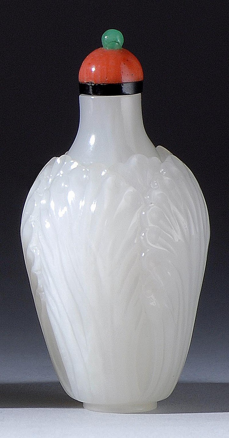 WHITE JADE SNUFF BOTTLE In cabbage leaf design. Height 2