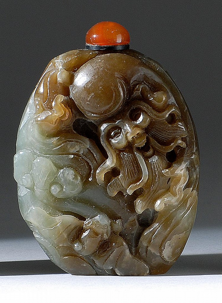 CELADON AND BROWN JADE SNUFF BOTTLE In pebble form depicting Shoulao and bats. Height 2½
