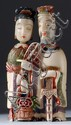 IVORY DOUBLE SNUFF BOTTLE In the form of a male and female figure holding sword and fan. Removable heads form stoppers. Height 3