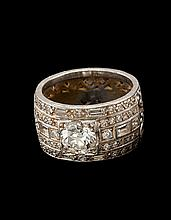 PLATINUM AND DIAMOND RING With (approximately) 1.6 carat diamond in a pavé setting. Size 6½.