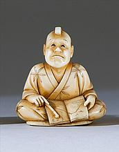 IVORY NETSUKE By Keimin. Depicting a seated man with an open book playing the paper-blowing game. Signed. Height 1.6
