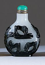OVERLAY GLASS SNUFF BOTTLE In pear shape with decoration of eight horses in black on a snowflake ground. Height 2.4