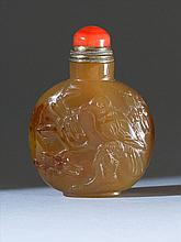 CHALCEDONY AGATE SNUFF BOTTLE In flattened ovoid form with relief bird and flower carving. Height 2.3