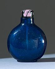 BLUE GLASS SNUFF BOTTLE In ovoid form with numerous air-bubble inclusions. Height 2.5