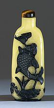 OVERLAY GLASS SNUFF BOTTLE In modified rectangular form with carp and lotus design in black on a yellow ground. Height 3.5