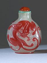 OVERLAY GLASS SNUFF BOTTLE In ovoid form. With red qilin decoration on a snowflake ground. Height 2.5