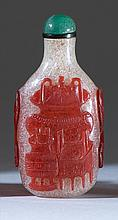 OVERLAY GLASS SNUFF BOTTLE In modified rectangular form. With decoration of bronze vessels in red on a snowflake ground. Height 2.5